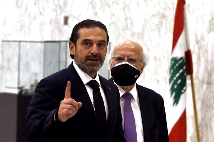 Lebanese Prime Minister-Designate Saad Hariri, gestures after his meeting with Lebanese President Michel Aoun, at the Presidential Palace in Baabda, east of Beirut, Lebanon, Thursday, March 18, 2021. Hariri said despite disagreements with the country's president there is still a chance to form a government to halt economic collapse and offer people hope. (AP Photo/Bilal Hussein)