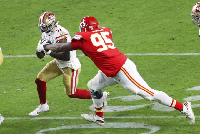 Kansas City Chiefs defensive end Chris Jones (95) brings down San Francisco 49ers running back Raheem Mostert (31) in the NFL Super Bowl football game, Sunday, Feb. 2, 2020 in Miami Gardens, Fla. The Chiefs defeated the 49ers 31-20.(Margaret Bowles via AP)