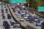 FILE - This April 16, 2020 file photo shows traffic on the Hollywood Freeway (U.S. 101) in Los Angeles. California Gov. Gavin Newsom said Wednesday, Sept. 23, 2020 that the state will halt sales of new gasoline-powered passenger cars and trucks by 2035. On Wednesday he ordered state regulators to come up with requirements to meet that goal. California would be the first state with such a rule, though Germany and France are among 15 other countries that have a similar requirement. (AP Photo/Mark J. Terrill, File)