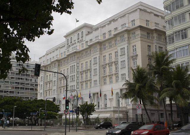 The Copacabana Palace hotel stands in Rio de Janeiro, Brazil, Thursday, April 9, 2020.Rio de Janeiro's stately Copacabana Palace hotel will close its doors on Friday for the first time since its inauguration 96 years ago as a result of the ongoing new coronavirus pandemic. (AP Photo/Silvia Izquierdo)