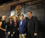 FILE - In this Sept. 20, 2010, file photo, members of the Steinbrenner family pose in front of George Steinbrenner's monument during a ceremony dedicating a monument to the late Yankees principal owner George Steinbrenner before the Yankees baseball game against the Tampa Bay Rays at Yankee Stadium in New York. From left are Steinbrenner's two daughters Jennifer Steinbrenner Swindal, and Jessica Steinbrenner, George Steinbrenner's widow Joan, and their sons Hal Steinbrenner and Hank Steinbrenner. Henry