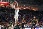 Miami forward Sam Waardenburg (21) scores during the second half of an NCAA college basketball game against Florida State on Saturday, Jan. 18, 2020, in Coral Gables, Fla. (AP Photo/Brynn Anderson)
