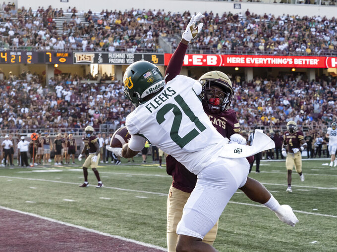 Texas State defensive back D.C. Williams, back, defends against a pass to Baylor receiver Josh Fleeks, who made the catch but was out of bounds during the first half of an NCAA college football game Saturday, Sept. 4, 2021, in San Marcos, Texas. (AP Photo/Michael Thomas)