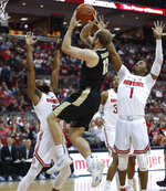 Purdue's Evan Boudreaux, center, shoots between Ohio State's Keyshawn Woods, left, and Luther Muhammad during the first half of an NCAA college basketball game Wednesday, Jan. 23, 2019, in Columbus, Ohio. (AP Photo/Jay LaPrete)