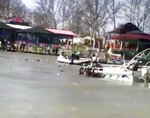 This image taken from video provided by Mohammed Issam shows boats trying to rescue people in the Tigris River after a overloaded ferry sank on Thursday, March 21, 2019 near Mosul, Iraq. Col. Hussam Khalil, head of the Civil Defense in the northern Nineveh province, told The Associated Press the accident occurred as scores of people were out in a tourist area celebrating Nowruz, which marks the Kurdish new year and the arrival of spring.  (Mohammed Issam via AP)