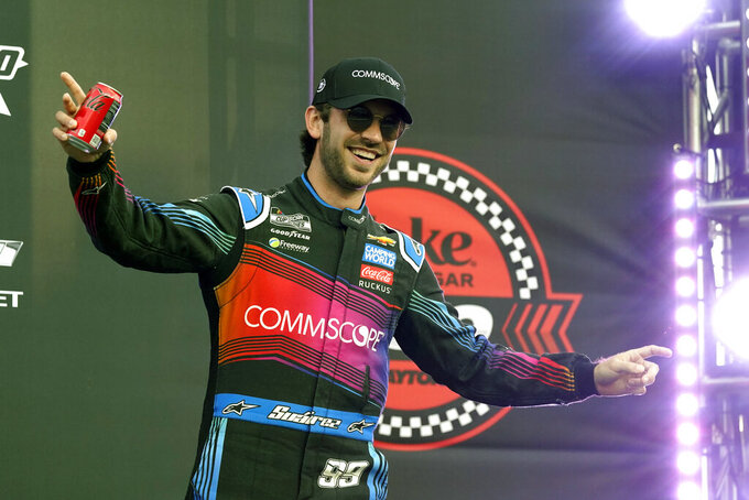 Daniel Suarez waves to fans during driver introductions before the NASCAR Cup Series auto race at Daytona International Speedway, Saturday, Aug. 28, 2021, in Daytona Beach, Fla. (AP Photo/John Raoux)