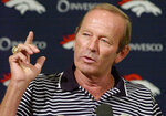 FILE - In this Aug. 20, 2002, file photo, Denver Broncos owner Pat Bowlen gestures during a news conference at the team's headquarters in Denver.  Pat Bowlen, the Denver Broncos owner who transformed the team from also-rans into NFL champions and helped the league usher in billion-dollar television deals, died late Thursday night, June 13, 2019, just under two months before his enshrinement in the Pro Football Hall of Fame. He was 75. In a statement posted on the Broncos' website, Bowlen's family said he died peacefully at home surrounded by loved ones. (AP Photo/Ed Andrieski, File)
