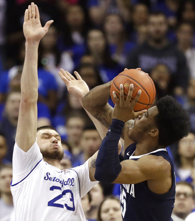 Seton Hall forward Sandro Mamukelashvili (23) defends as Villanova forward Saddiq Bey (15) looks to pass during the second half of an NCAA college basketball game, Saturday, March 9, 2019, in Newark, N.J. Seton Hall defeated Villanova 79-75. (AP Photo/Kathy Willens)