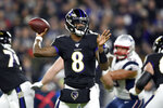 Baltimore Ravens quarterback Lamar Jackson throws a pass against the New England Patriots during the first half of an NFL football game, Sunday, Nov. 3, 2019, in Baltimore. (AP Photo/Gail Burton)