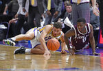 LSU guard Marshall Graves (12) and Texas A&M guard Jay Jay Chandler (0) dive after a loose ball in the first half of an NCAA college basketball game, Tuesday, Feb. 26, 2019, in Baton Rouge, La. (AP Photo/Bill Feig)