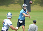 Carolina Panthers quarterback Sam Darnold, center, passes over the middle to tight end Colin Thompson, left, on a play during the team's NFL football practice on Tuesday, May 25, 2021 in Charlotte, N.C. (Jeff SIner/The Charlotte Observer via AP)
