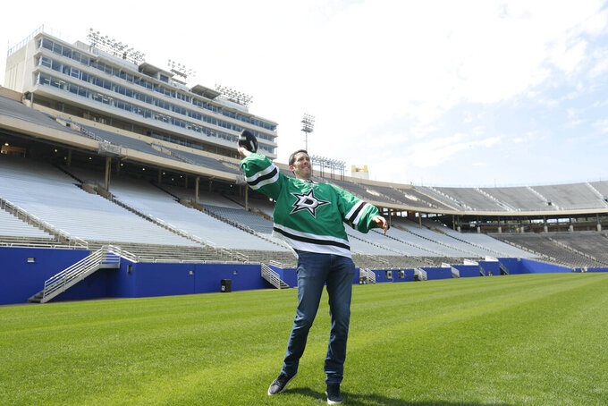 Dallas Stars goaltender Ben Bishop tosses a football while touring the playing field of the Cotton Bowl in Dallas, Wednesday, March 20, 2019. The NHL Winter Classic hockey game between the Nashville Predators and the Dallas Stars will be played Jan. 1, 2020, at the Cotton Bowl in Dallas. (AP Photo/LM Otero)