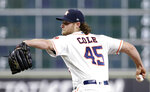 FILE - In this Sept. 2, 2018, file photo, Houston Astros starting pitcher Gerrit Cole (45) throws against the Los Angeles Angels during the first inning of a baseball game, in Houston. The Astros have plenty of reasons to be confident with a big chunk of last year's squad which won a franchise-record 103 games. That group is led by a bevy of stars including 2017 AL MVP Jose Altuve, shortstop Carlos Correa, third baseman Alex Bregman, 2017 World Series MVP George Springer and starters Justin Verlander and Cole, who combined for 31 wins and 566 strikeouts in 2018. (AP Photo/Michael Wyke, File)