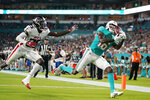 Miami Dolphins wide receiver Robert Foster (16) grabs a pass for a touchdown ahead of Atlanta Falcons running back Delrick Abrams Jr (25) during the second half of a preseason NFL football game, Saturday, Aug. 21, 2021, in Miami Gardens, Fla. (AP Photo/Lynne Sladky)