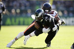 Philadelphia Eagles' Miles Sanders, left, is tackled by Chicago Bears' James Vaughters during the first half of an NFL football game, Sunday, Nov. 3, 2019, in Philadelphia. (AP Photo/Matt Rourke)