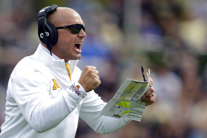 FILE - In this Sept. 28, 2019, file photo, Minnesota head coach P.J. Fleck celebrates a touchdown during the first half of an NCAA college football game against Purdue in West Lafayette, Ind. With another Gophers player opting out of the season Monday, coach P.J. Fleck warned more could follow before the Oct. 24 opener. (AP Photo/Michael Conroy, File)