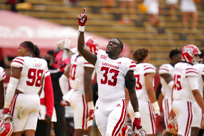 Louisiana-Lafayette linebacker Tyler Guidry celebrates on the sideline during the second half of an NCAA college football game against Iowa State, Saturday, Sept. 12, 2020, in Ames, Iowa. Louisiana-Lafayette won 31-14. (AP Photo/Charlie Neibergall)