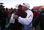 Fresno State head coach Jeff Tedford, right, embraces Arizona State head coach Herm Edwards after the Las Vegas Bowl NCAA college football game, Saturday, Dec. 15, 2018, in Las Vegas. (AP Photo/John Locher)