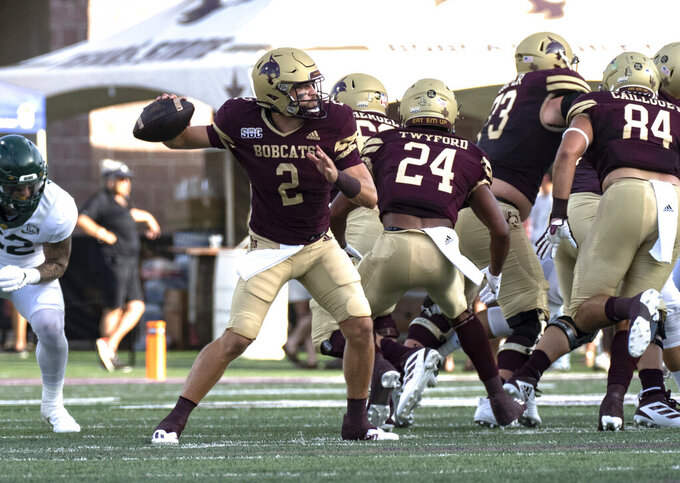 Texas State quarterback Brady McBride (2) looks for a receiver during the first half of the team's NCAA college football game against Baylor, Saturday, Sept. 4, 2021, in San Marcos, Texas. (AP Photo/Michael Thomas)