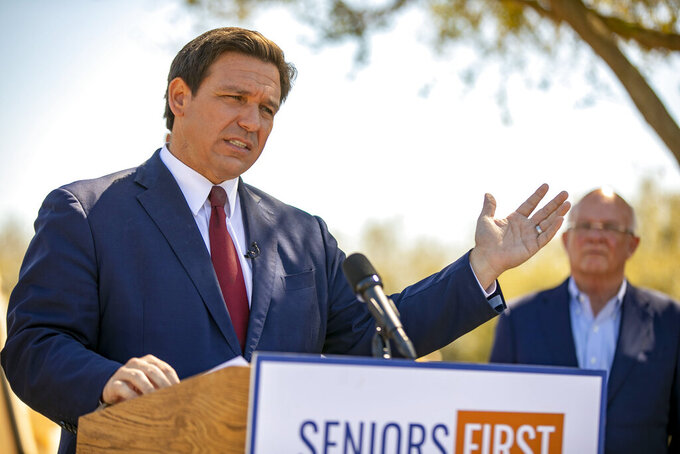 Florida Gov. Ron DeSantis speaks to the media as he visited the drive-thru COVID-19 vaccination site at On Top of the World in Ocala, Fla., on Friday, March 5, 2021.  (Alan Youngblood/Ocala Star-Banner via AP)