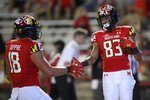 Maryland wide receiver Carlos Carriere (83) celebrates his touchdown with tight end CJ Dippre (18) during the second half of an NCAA college football game against Howard, Saturday, Sept. 11, 2021, in College Park, Md. (AP Photo/Nick Wass)