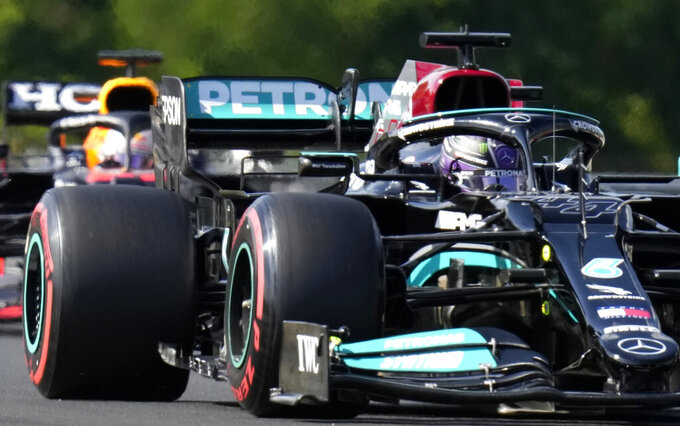 Mercedes driver Valtteri Bottas of Finland steers his car followed by Red Bull driver Max Verstappen of the Netherlands during the qualifying session for the Hungarian Formula One Grand Prix at the Hungaroring racetrack in Mogyorod, Hungary, Saturday, July 31, 2021. The Hungarian Formula One Grand Prix will be held on Sunday. (AP Photo/Darko Bandic)