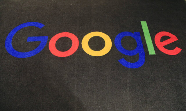 FILE - In this Monday, Nov. 18, 2019 file photo, the logo of Google is displayed on a carpet at the entrance hall of Google France in Paris. France's competition authority has fined Google 150 million euros ($166 million) for