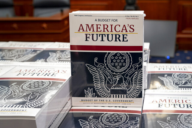 President Donald Trump's budget request for fiscal year 2021 arrives at the House Budget Committee on Capitol Hill in Washington, Monday, Feb. 10, 2020. (AP Photo/J. Scott Applewhite)