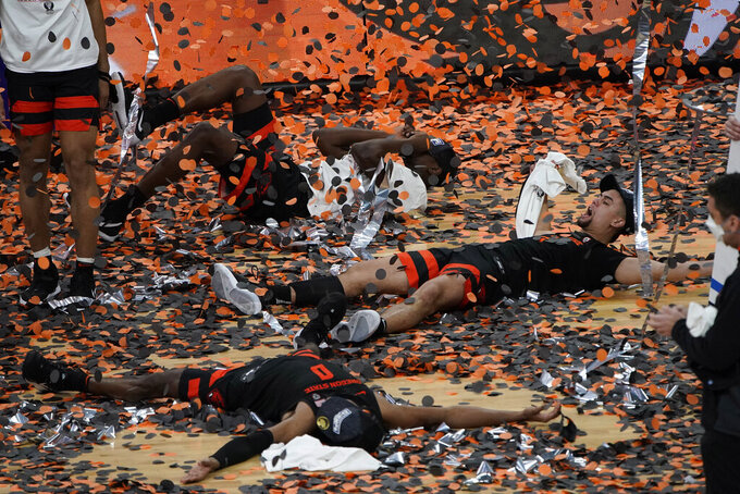 Oregon State's Jarod Lucas, right, celebrates with teammates after defeating Colorado in an NCAA college basketball game in the championship of the Pac-12 men's tournament Saturday, March 13, 2021, in Las Vegas. (AP Photo/John Locher)
