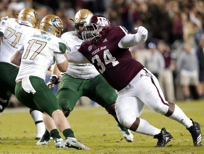 UAB quarterback Tyler Johnston III (17) is caught for the sack by Texas A&M defensive lineman Daylon Mack (34) during the first half of an NCAA college football game Saturday, Nov. 17, 2018, in College Station, Texas. (AP Photo/Michael Wyke)