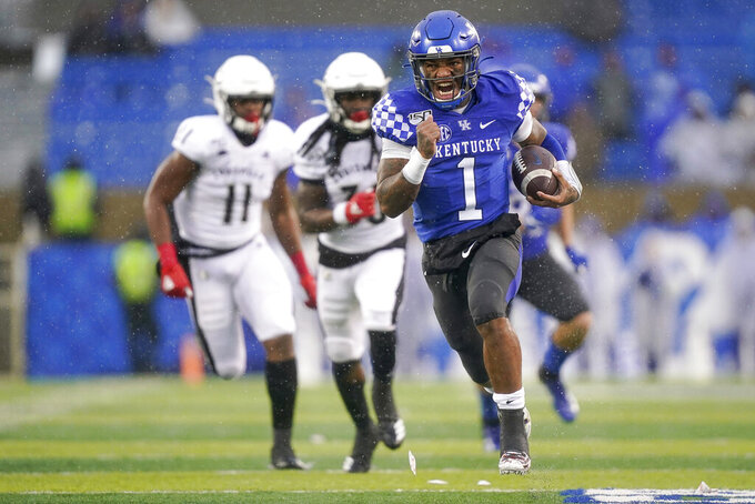 Kentucky quarterback Lynn Bowden Jr. (1) runs for a touchdown during the second half of the NCAA college football game against Louisville, Saturday, Nov. 30, 2019, in Lexington, Ky. (AP Photo/Bryan Woolston)