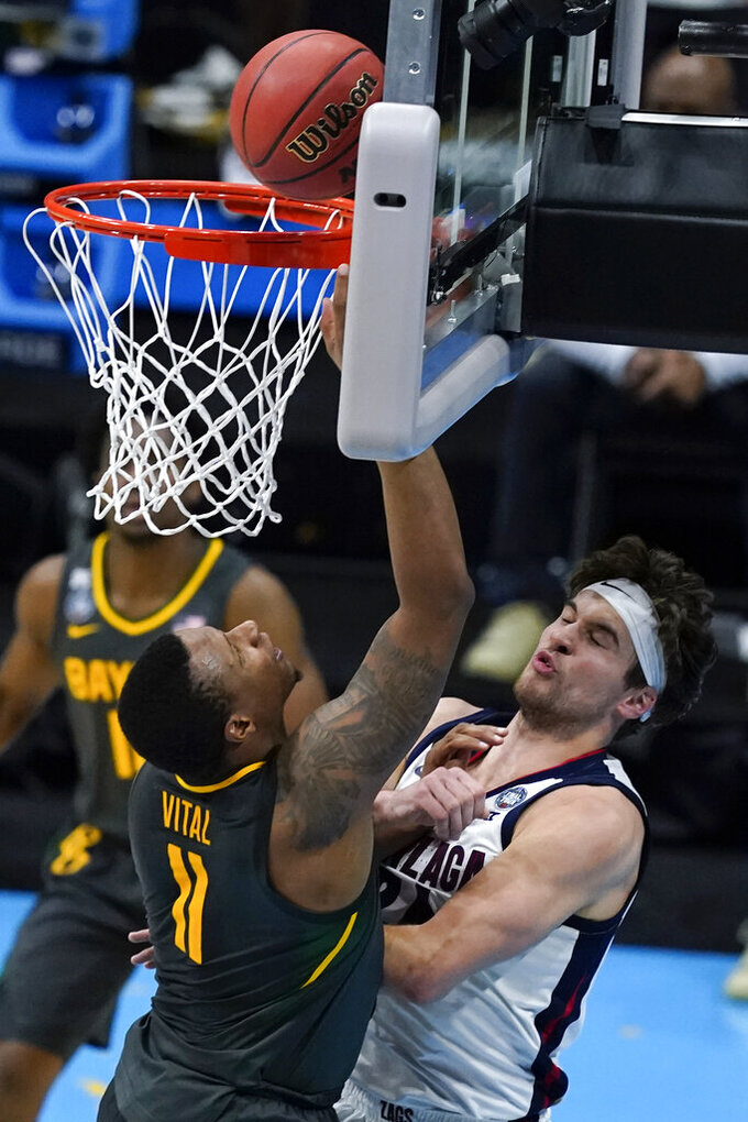 Baylor guard Mark Vital (11) shoots over Gonzaga forward Corey Kispert (24) during the second half of the championship game in the men's Final Four NCAA college basketball tournament, Monday, April 5, 2021, at Lucas Oil Stadium in Indianapolis. (AP Photo/Darron Cummings)