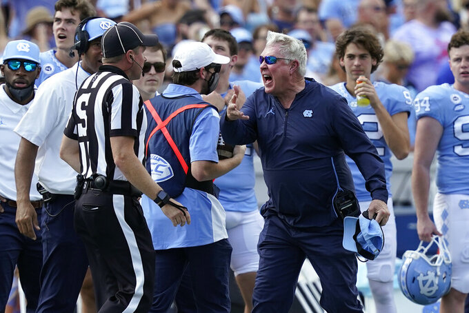 North Carolina head coach Mack Brown reacts during the first half of an NCAA college football game against Duke in Chapel Hill, N.C., Saturday, Oct. 2, 2021. (AP Photo/Gerry Broome)