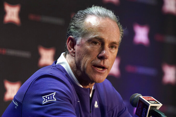 TCU coach Jamie Dixon speaks to the media during Big 12 NCAA college basketball media day Wednesday, Oct. 20, 2021, in Kansas City, Mo. (AP Photo/Charlie Riedel)