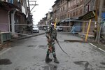 An Indian paramilitary soldier stands guard by a closed road, as Kashmiris marked Eid during lockdown to curb the spread of coronavirus in in Srinagar, Indian controlled Kashmir, Saturday, Aug. 1, 2020. (AP Photo/Mukhtar Khan)