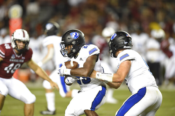Eastern Illinois running back Kendi Young (29) receives handoff from quarterback Chris Katrenick (9) during the second half of an NCAA college football game against against South Carolina, Saturday, Sept.4, 2021, in Columbia, S.C. (AP Photo/Hakim Wright Sr.)
