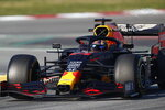 Aston Martin Red Bull Racing's Alexander Albon drives during a Formula One pre-season testing session at the Barcelona Catalunya racetrack in Montmelo, outside Barcelona, Spain, Thursday, Feb. 20, 2020. (AP Photo/Joan Monfort)