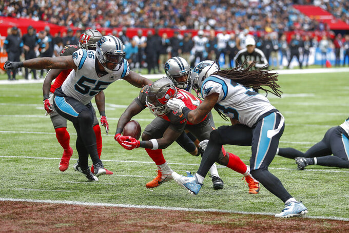Tampa Bay Buccaneers running back Ronald Jones (27) crosses the goal line to score a touchdown against the Carolina Panthers during the second quarter of an NFL football game, Sunday, Oct. 13, 2019, at Tottenham Hotspur Stadium in London. (AP Photo/Alastair Grant)