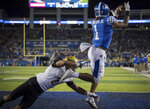 Kentucky wide receiver Lynn Bowden Jr. (1) catches a touchdown pass during the first half of an NCAA college football game against Vanderbilt in Lexington, Ky., Saturday, Oct. 20, 2018. (AP Photo/Bryan Woolston)