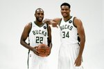 Milwaukee Bucks' Giannis Antetokounmpo and Khris Middleton pose for a picture during an NBA basketball media day Monday, Sept. 27, 2021, in Milwaukee. (AP Photo/Morry Gash)