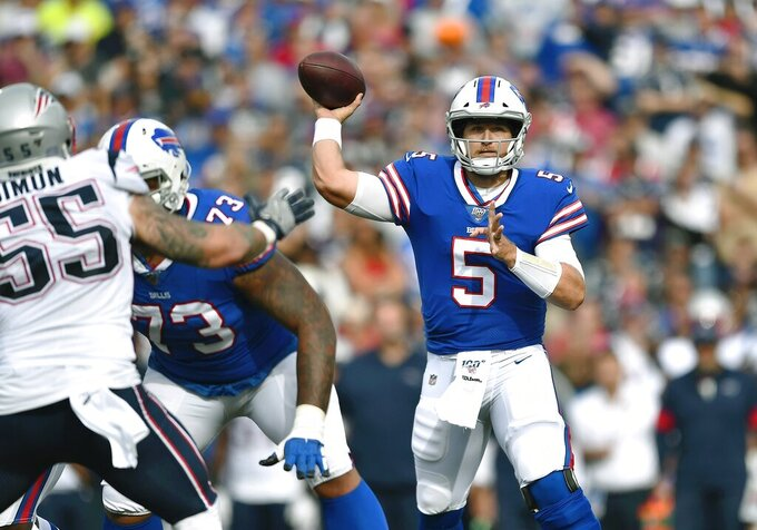 Buffalo Bills quarterback Matt Barkley passes against the New England Patriots in the second half of an NFL football game, Sunday, Sept. 29, 2019, in Orchard Park, N.Y. (AP Photo/Adrian Kraus)