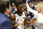 Butler guard Kamar Baldwin (3) is congratulated by fans after hitting the game-winning shot at the buzzer against Villanova in an NCAA college basketball game in Indianapolis, Wednesday, Feb. 5, 2020. Butler won 79-76. (AP Photo/AJ Mast)