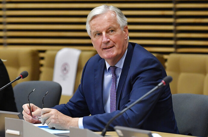 European Union's Brexit negotiator Michel Barnier waits for start of a meeting on further Brexit negotiations at EU headquarters in Brussels, Monday, June 29, 2020. European Union and U.K. negotiators resumed in-person talks on a post-Brexit trade deal on Monday, with both sides insisting that the process must accelerate markedly if they're to reach an agreement by the end of the year. (John Thys, Pool Photo via AP)