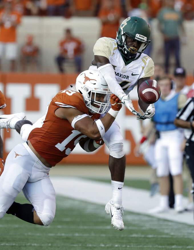 Texas defensive back Brandon Jones (19) breaks up a pass intended for Baylor wide receiver Chris Platt (14) during the second half of an NCAA college football game, Saturday, Oct. 13, 2018, in Austin, Texas. (AP Photo/Eric Gay)