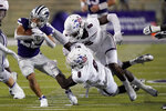 Kansas State running back Deuce Vaughn (22) gets past Southern Illinois linebacker Makel Calhoun (8) and safety Jakari Patterson (6) during the second half of an NCAA college football game, Saturday, Sept. 11, 2021, in Manhattan, Kan. Kansas State won 31-23(AP Photo/Charlie Riedel)