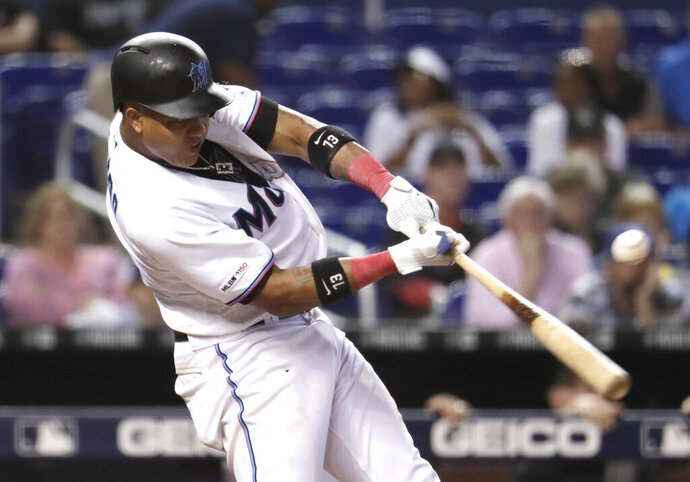 FILE - In this Aug. 15, 2019, file photo, Miami Marlins' Starlin Castro hits an RBI single to score Brian Anderson during the sixth inning of a baseball game against the Los Angeles Dodgers, in Miami. Infielder Starlin Castro finalized a two-year contract with the Washington Nationals on Tuesday, Jan. 7, 2020, one of a flurry of recent moves by the World Series champions. Castro's deal gives the club someone who can start at second base and maybe also play some at third, where Anthony Rendon left as a free agent. (AP Photo/Lynne Sladky, File)