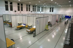 Beds are ready to receive the first patients at a field hospital set up in a sports hall in Lisbon, Wednesday, Jan. 20, 2021. Portugal's new daily COVID-19 cases have jumped to more than 14,600 to set a new national record. The pandemic has gained momentum in Portugal since Christmas, when restrictions on gatherings and movement were eased for four days. (AP Photo/Armando Franca)