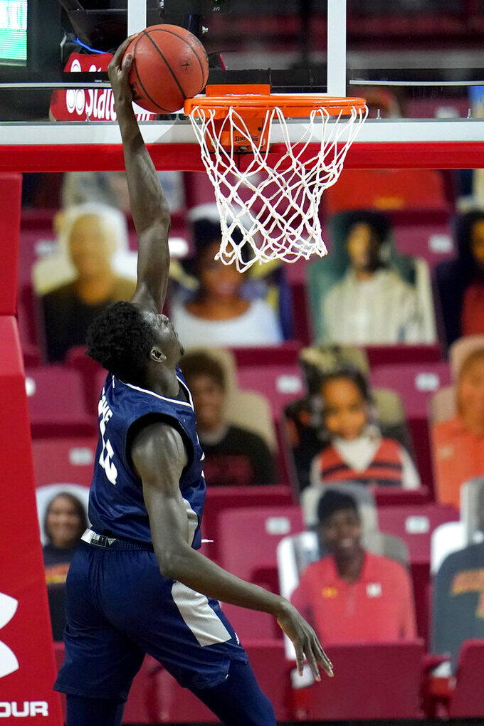 St. Peter's forward Fousseyni Drame fails a dunk attempt against Maryland during the first half of an NCAA college basketball game, Friday, Dec. 4, 2020, in College Park, Md. (AP Photo/Julio Cortez)