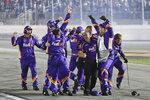 Denny Hamlin's crew celebrates after Hamlin won the NASCAR Daytona 500 auto race at Daytona International Speedway, Monday, Feb. 17, 2020, in Daytona Beach, Fla. (AP Photo/Terry Renna)