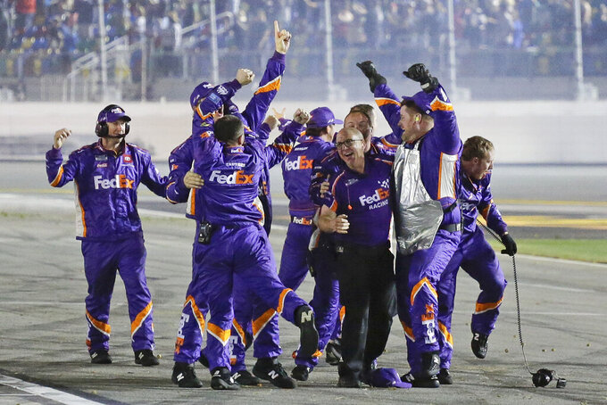 Denny Hamlin's crew celebrates after Hamlin won the NASCAR Daytona 500 auto race at Daytona International Speedway, Monday, Feb. 17, 2020, in Daytona Beach, Fla. (AP Photo/Terry Renna)